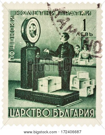 MOSCOW RUSSIA - February 20 2017: A stamp printed in Bulgaria shows weighing parcels at the old post office circa 1940