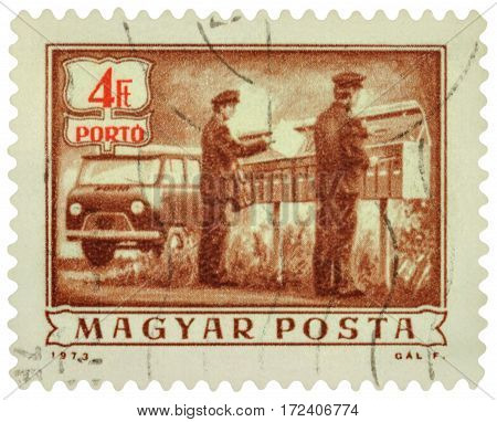 MOSCOW RUSSIA - February 19 2017: A stamp printed in Hungary shows two postmen laid out letters to mailboxes circa 1973