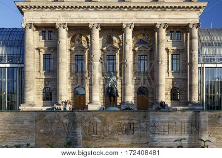 MUNICH, GERMANY - OCTOBER 31, 2015: The Bavarian State Chancellery is serving as the executive office of the Minister-President as head of government with the statue of Otto von Wittelsbach in front