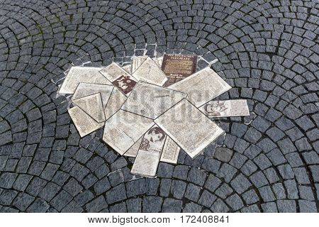 MUNICH, GERMANY - OCTOBER 31, 2015: White Rose memorial with leaflets in front of the main building of the Ludwig Maximilians University in Munich to remember the student group White Rose that formed an active opposition against the Nazi regime