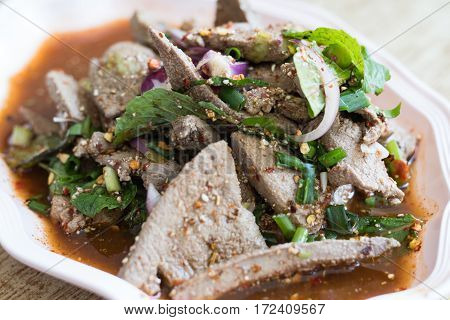 Hot and spicy pork liver with herb salad