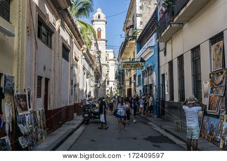 La Havana Cuba - December 26 2016: street view with tourists in front of La Bodega de Medio most famous bar in Cuba general travel imagery
