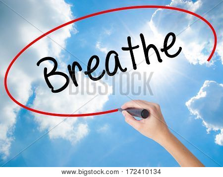 Woman Hand Writing Breathe   With Black Marker On Visual Screen