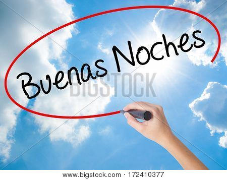 Woman Hand Writing Buenas Noches (good Night In Spanish) With Black Marker On Visual Screen.