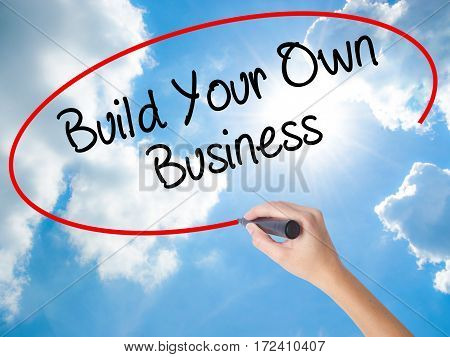 Woman Hand Writing Build Your Own Business With Black Marker On Visual Screen.