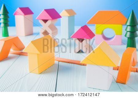 Wooden construction toys. Baby building bricks. Kids wooden cubic blocks on blue background. Colorful toy blocks. Educational wooden toys.