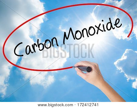 Woman Hand Writing Carbon Monoxide  With Black Marker On Visual Screen
