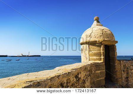 Turret of medieval Castle of Santa Catalina at the seafront of Cadiz Spain.
