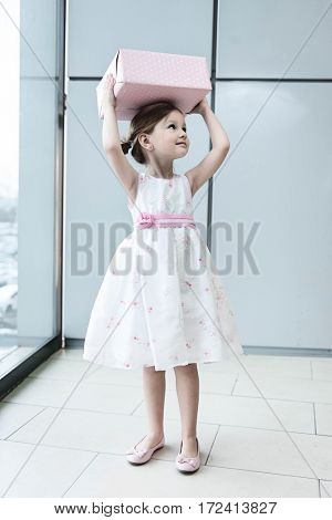 Young girl holding two gift wrapped boxes