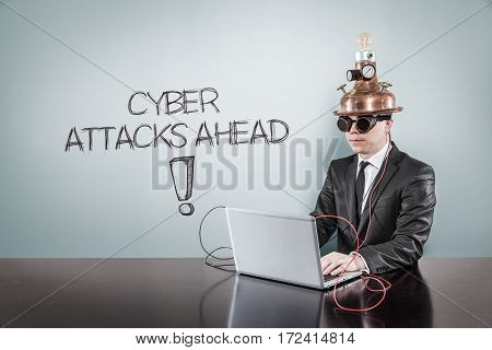 Cyber attacks ahead text with vintage businessman using laptop at office
