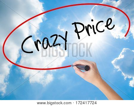 Woman Hand Writing Crazy Price With Black Marker On Visual Screen