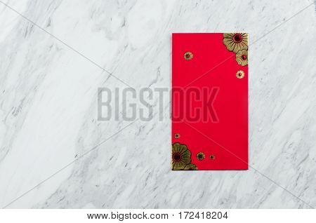 Chinese new year. Red packet on white marble background. Isolated. Copy space