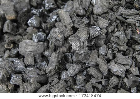 natural black background pieces of charcoal. natural texture of natural coal