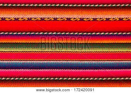 Peruvian traditional woven wool fabric background, Latin America
