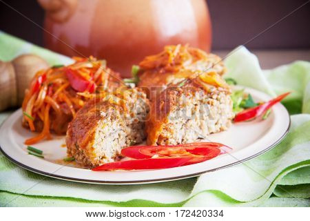 fish cutlets with tomato sauce on plate
