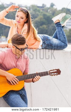 Love sound romance dating passion concept. Couple spending time together. Girl listening to her boyfriends music.