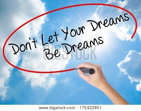 Woman Hand Writing Don't Let Your Dreams Be Dreams With Black Marker On Visual Screen