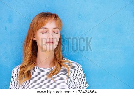Young Red Hair Woman With Eyes Closed