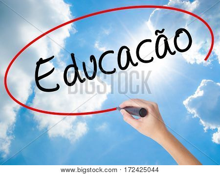 Woman Hand Writing Education (educacao In Portuguese) With Black Marker On Visual Screen