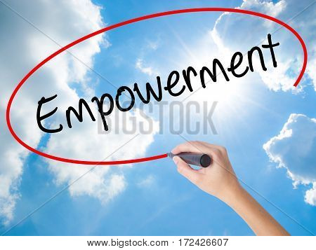 Woman Hand Writing Empowerment With Black Marker On Visual Screen.