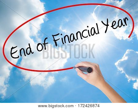 Woman Hand Writing End Of Financial Year With Black Marker On Visual Screen