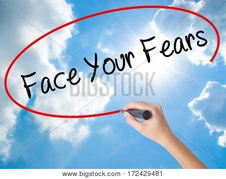 Woman Hand Writing Face Your Fears With Black Marker On Visual Screen