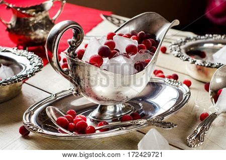 Cubes Of Natural Ice And Cranberries In A Beautiful Silver Vase