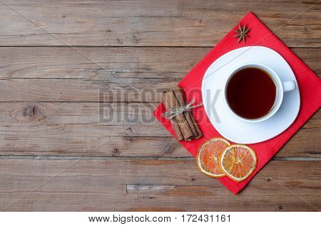 A Cup Of Hot Tea On A Wooden Table.