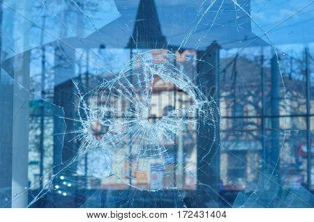 bullets pierced the glass in the window in city street