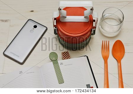 Brunch break served with thai-styled food containers calling bento - good time for put the cell screen down