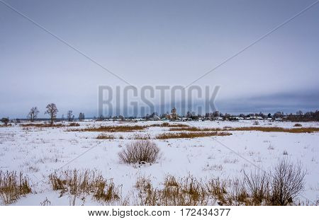 Beautiful winter rural landscape on a cloudy day Russia.