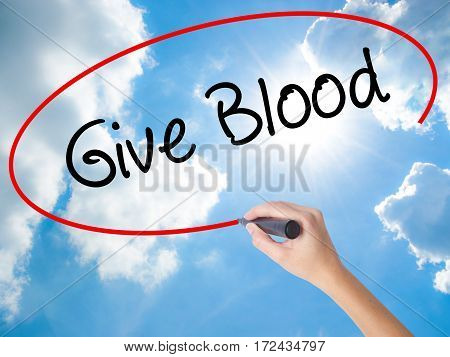 Woman Hand Writing Give Blood  With Black Marker On Visual Screen