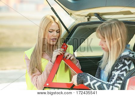 Women On The Road With Broken Car