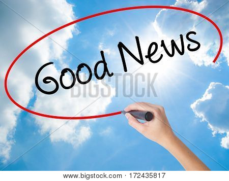 Woman Hand Writing Good News With Black Marker On Visual Screen
