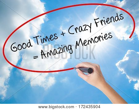 Woman Hand Writing Good Times + Crazy Friends = Amazing Memories With Black Marker On Visual Screen