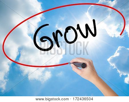 Woman Hand Writing  Grow With Black Marker On Visual Screen