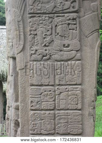 ancient hand carved stone hieroglyphs at a Mayan archeological site in Quirigua Guatemala