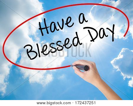 Woman Hand Writing Have A Blessed Day  With Black Marker On Visual Screen