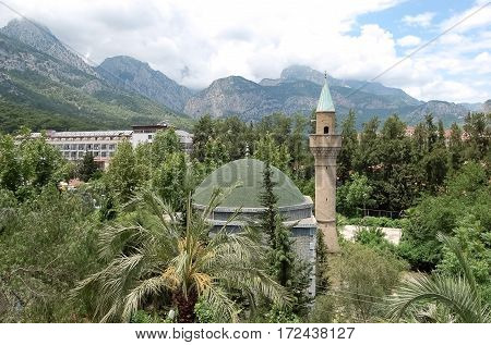 View of the mosque in a green garden on the Antalya coast of the Mediterranean Sea in Turkey.
