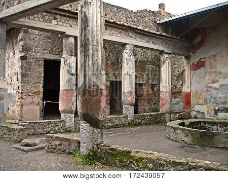 Ruins of Pompeii. Streets, shops, eateries and wine bars in the ancient city near Naples, Italy as it was destroyed by volcanic eruption of Mount Vesuvius in 79 AD