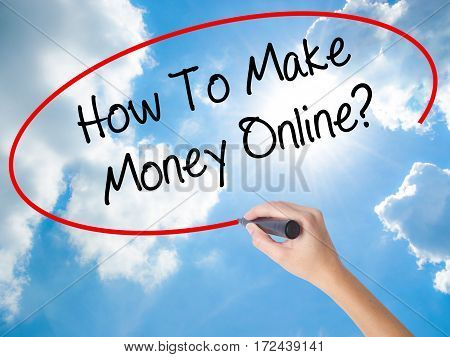 Woman Hand Writing How To Make Money Online? With Black Marker On Visual Screen