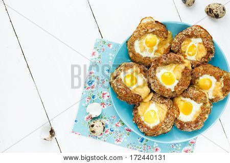Meat bird nests with quail eggs top view