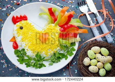 Easter appetizer salad shaped chicken or hen decorated with egg yolk colorful pepper and parsley