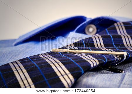 Tie and blue shirt commercial photo: blue shirt with focus on tie.