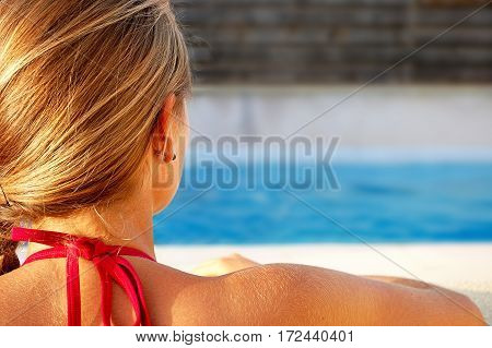 Summertime: Girl at pool with swimming pool.