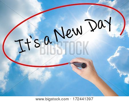 Woman Hand Writing It's A New Day With Black Marker On Visual Screen