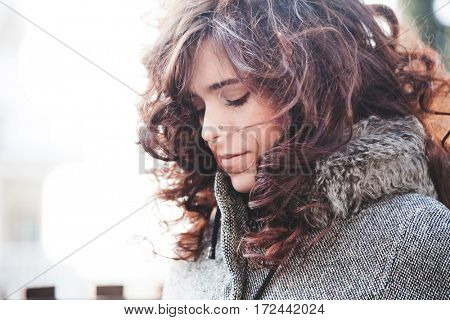 portrait of young woman with natural curly hair profile outdoor closeup