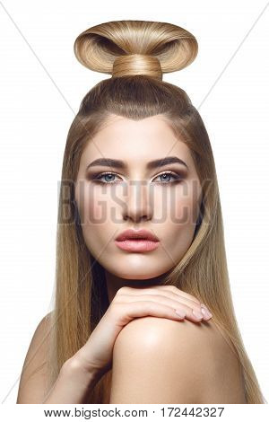 Beautiful young woman with long straight blond hair and fancy hairdo on top of head. Eyes closed. Isolated on white background. Copy space.