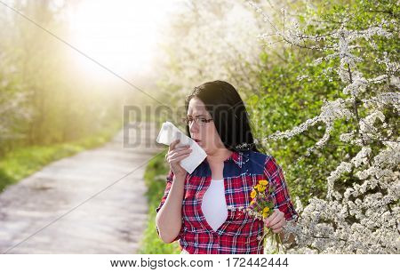 Girl Having Allergy And Sneezing In Tissue