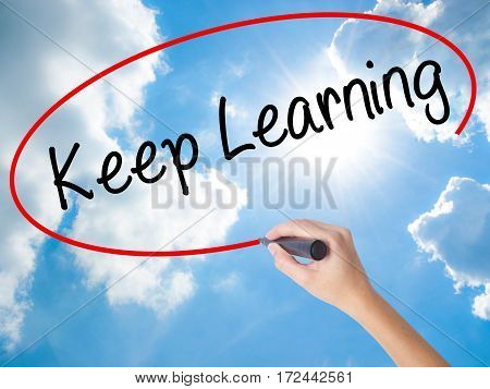 Woman Hand Writing Keep Learning With Black Marker On Visual Screen